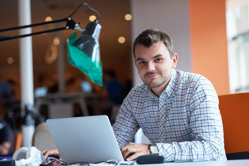 entrepreneur working remotely in computer